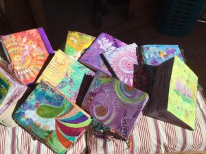 These are handpainted covered sketchbooks