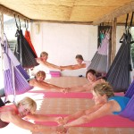 Partner Yoga in the yoga swings