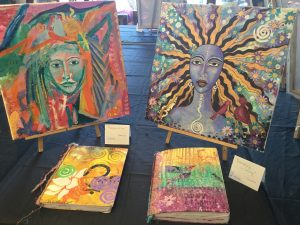 Display of finished paintings and hand covered books